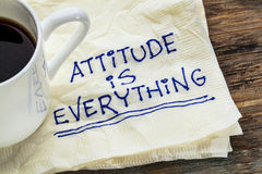 Attitude is everything. Motivational slogan on a napkin with a cup of coffee stock image