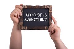 Attitude is everything. A woman holding chalkboard with words attitude is everything isolated on white background royalty free stock photography