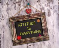 Attitude is everything written on Vintage sign board. Attitude is everything written on Vintage wooden sign board hanging on color white wood with heart and royalty free stock photography