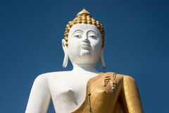 The attitude of meditation big buddha against blue sky Royalty Free Stock Images