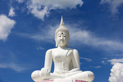 The attitude of meditation white buddha against blue sky. Stock Photo