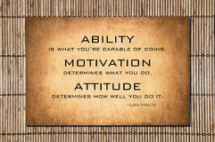 Attitude quote by Lou Holtz over bamboo background Royalty Free Stock Images
