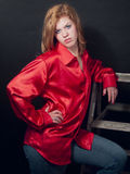 Attitude in a Red Shirt. Beautiful young redhead working the pose for the camera Royalty Free Stock Photos