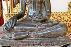The attitude of Subduing Mara. Posture of the Buddha image : The attitude of Subduing Mara at veranda of Haw Phra Kaew Temple.Vientiane.Laos stock photo