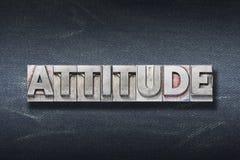 Attitude word den. Attitude word made from metallic letterpress on dark jeans background royalty free stock photos