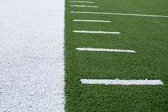 Attività collaterale del fondo del campo di football americano immagini stock