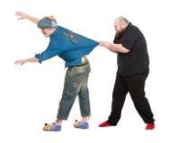 Attore Dressed come eroe di fiaba che parla con Fatman Fotografia Stock