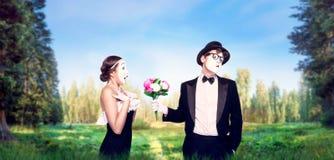 Attori del mimo che eseguono con il mazzo del fiore Fotografia Stock Libera da Diritti