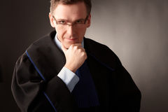 Attorney. Wearing classic gown thinking in court Royalty Free Stock Photography