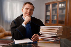 Attorney. Wearing classic gown in his office Stock Photos