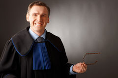 Attorney. Wearing classic gown thinking in court stock photography