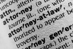 Attorney. A macro photo of the definition of the word Attorney and Attorney at Law. Lots of texture in the paper royalty free stock photo