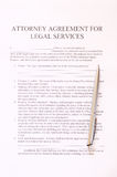 Attorney agreement for legal services form and pen. top view Royalty Free Stock Images