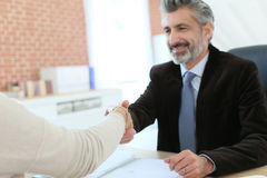 Attorney and client handshaking Royalty Free Stock Photo