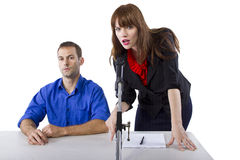 Attorney. Female lawyer representing male client in a court hearing Stock Image