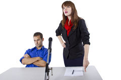 Attorney. Female lawyer representing male client in a court hearing Royalty Free Stock Photo
