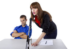Attorney. Female lawyer representing male client in a court hearing Stock Photography