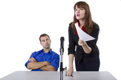 Attorney. Female lawyer representing male client in a court hearing royalty free stock images