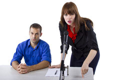 Attorney. Female lawyer representing male client in a court hearing Stock Photos