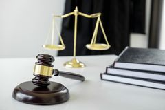 Attorney`s suit, Law books, a gavel and scales of justice on a w Stock Image