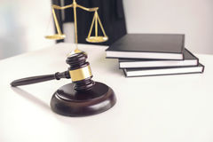 Attorney`s suit, Law books, a gavel and scales of justice on a w Stock Photo
