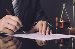 Attorney in suit working in office. Law lawyer pen business man notary scale concept Royalty Free Stock Photography