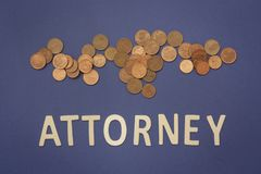 Attorney written with wooden letters on a blue background. To mean a business concept Stock Photo