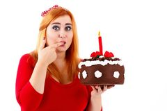 Attracitve plump woman holding birthday cake. Isolated studio portrait of woman with cake Royalty Free Stock Photo