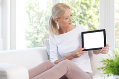 Attracitve woman holding digital tablet Royalty Free Stock Photos