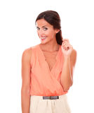 Attracitve young lady in elegant blouse smiling Royalty Free Stock Images