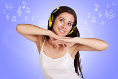 Attracive girl is listening music with headphones Stock Photos