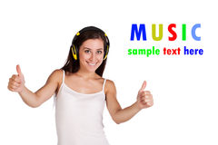 Attracive girl is listening music on headphones Stock Photography