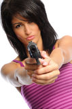 Attracive woman with gun. Attractive young hispanic woman on a white background holding a pistol Stock Photo