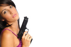 Attracive woman with gun Stock Photo