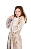 Attracive young woman in a fur coat isolated Royalty Free Stock Photography