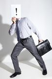 Attracting attention. Portrait of moving businessman holding paper with exclamatory mark on it by his face Stock Images