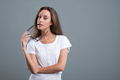 Attracting girl with a sidepiece in her mouth Royalty Free Stock Image