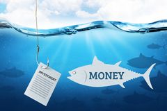 Attracting money in investments. Fishing hook with bait investment for investors. Blue underwater sea background. Attracting money in investments. Fishing hook royalty free stock photography