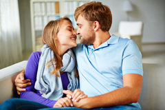 Attraction. Amorous young couple having rest at home Stock Photo