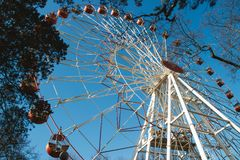Attraction a big wheel. Against the background of the blue sky. Shooting was conducted from below up Royalty Free Stock Photos