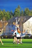 Attraction de Lacrosse de filles photographie stock libre de droits