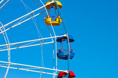 Attraction Ferris wheel. On blue sky background Royalty Free Stock Photo