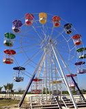 Attraction Ferris wheel. At Amusement park on sunny day Stock Images