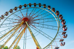 Attraction ferris wheel. On a background of clear sky on a summer day Stock Image