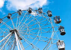 Attraction Ferris wheel on the blue sky background. Attraction Ferris wheel on the bright blue sky background Royalty Free Stock Photos