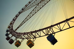 Attraction Ferris wheel. Brightly colored Ferris wheel against the blue sky Royalty Free Stock Photography