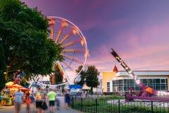 Attraction Ferris Wheel On Summer Evening In City Amusement Park.  Stock Photo