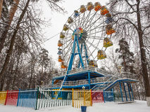 Attraction Ferris wheel in the winter day Stock Photos