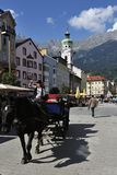 Attraction at Innsbruck's Square. Horse carriage as the attraction at the town square in Innsbruck - Austria Royalty Free Stock Image