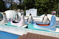 Attraction with penguins. Water slide with penguins in the children's amusement park Royalty Free Stock Photography